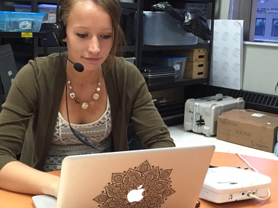 SDSU student takes call in questions at Yeager Media Center during On Call with the Prairie Doc