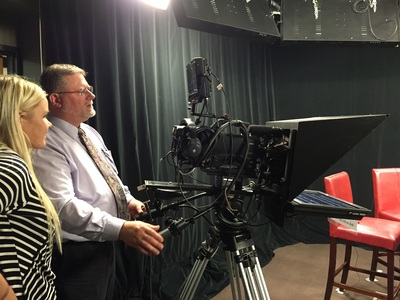 Lowell Haag demonstrates studio camera operation at On Call with the Prairie Doc at yeager Media Center on the campus of SDSU in Brookings, SD.
